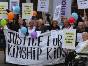 Kinship Carers from North Glasgow demonstrate outside parliament in 2010
